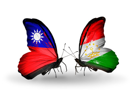 economy of tajikistan: Two butterflies with flags on wings as symbol of relations Taiwan and Tajikistan Stock Photo