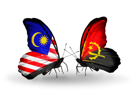 Two butterflies with flags on wings as symbol of relations Malaysia and  Angola photo
