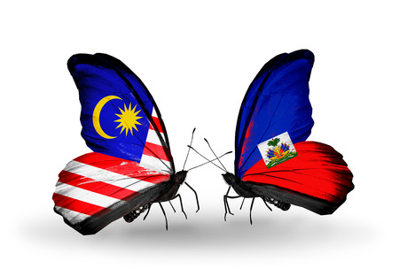 Two butterflies with flags on wings as symbol of relations Malaysia and Haiti photo