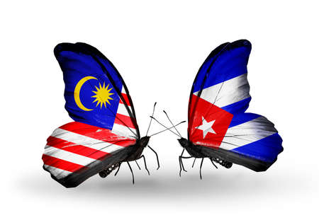 Two butterflies with flags on wings as symbol of relations Malaysia and Cuba
