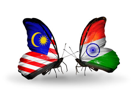 Two butterflies with flags on wings as symbol of relations Malaysia and  India photo