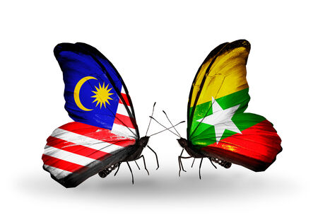 Two butterflies with flags on wings as symbol of relations Malaysia and Myanmar photo