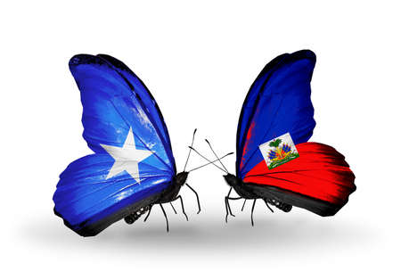 Two butterflies with flags on wings as symbol of relations Somalia and Haiti photo
