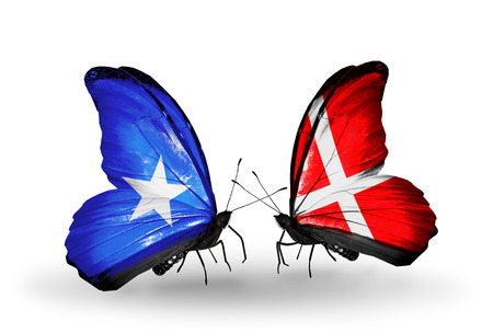 Two butterflies with flags on wings as symbol of relations Somalia and Denmark photo