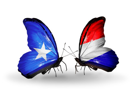 Two butterflies with flags on wings as symbol of relations Somalia and Holland photo