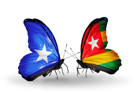 Two butterflies with flags on wings as symbol of relations Somalia and Togo photo