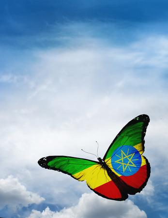 ethiopia flag: Ethiopia flag butterfly flying on sky background Stock Photo