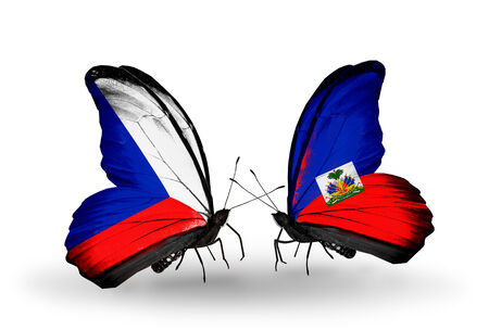 Two butterflies with flags on wings as symbol of relations Czech and  Haiti photo