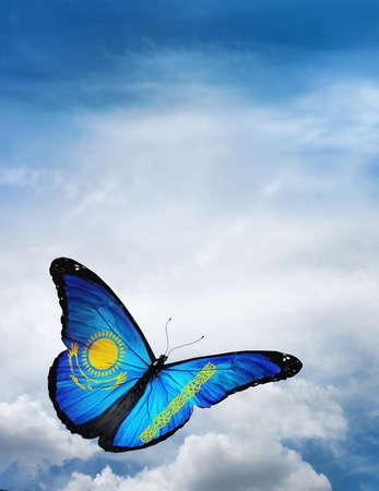 Kazakhstan flag butterfly flying on sky background photo