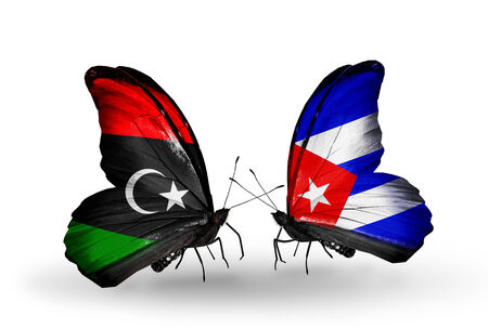 Two butterflies with flags on wings as symbol of relations Libya and Cuba Stock Photo