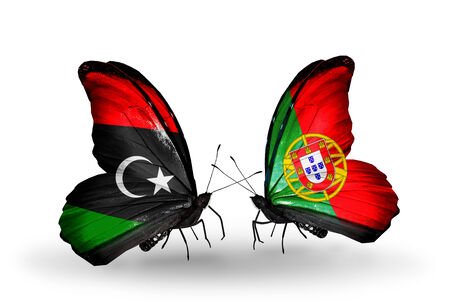 Two butterflies with flags on wings as symbol of relations Libya and Portugal photo