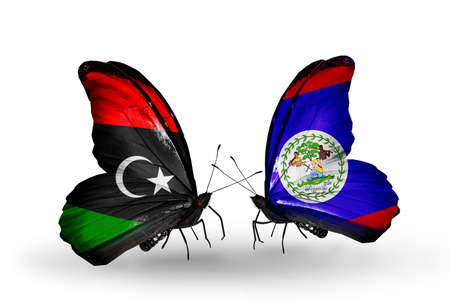 Two butterflies with flags on wings as symbol of relations Libya and Belize photo