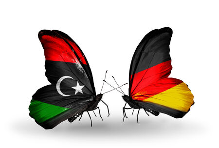 Two butterflies with flags on wings as symbol of relations Libya and Germany photo