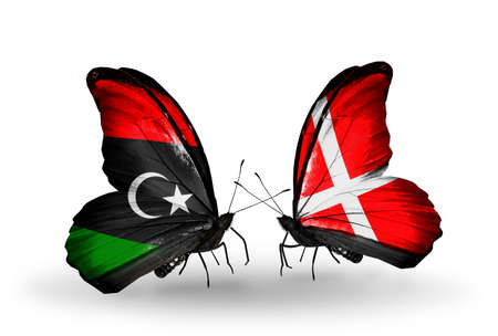 Two butterflies with flags on wings as symbol of relations Libya and Denmark photo