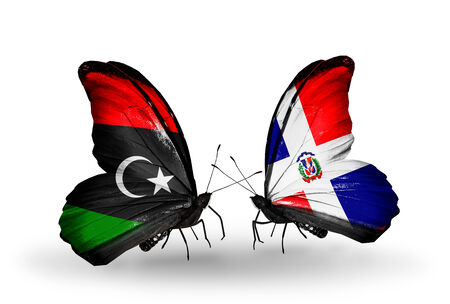 Two butterflies with flags on wings as symbol of relations Libya and Dominicana photo