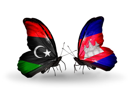 Two butterflies with flags on wings as symbol of relations Libya and Cambodia photo