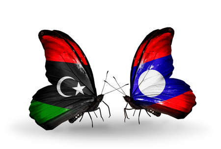 Two butterflies with flags on wings as symbol of relations Libya and Laos photo