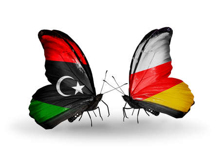 Two butterflies with flags on wings as symbol of relations Libya and South Ossetia photo