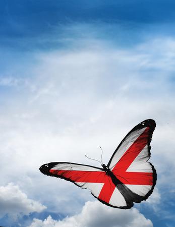 alabama flag: Alabama flag butterfly flying on sky background Stock Photo