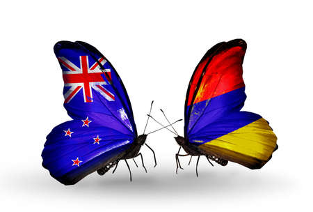 Two butterflies with flags on wings as symbol of relations New Zealand and Armenia photo