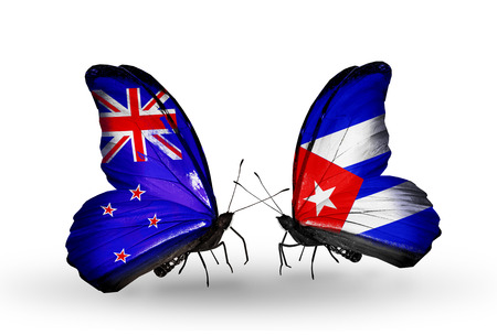 Two butterflies with flags on wings as symbol of relations New Zealand and Cuba Stock Photo