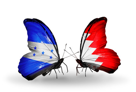 bahrain money: Two butterflies with flags on wings as symbol of relations Honduras and Bahrain