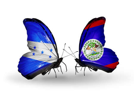Two butterflies with flags on wings as symbol of relations Honduras and Belize photo