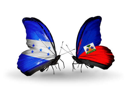 Two butterflies with flags on wings as symbol of relations Honduras and Haiti photo
