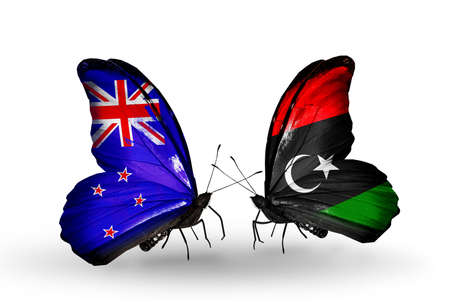 Two butterflies with flags on wings as symbol of relations New Zealand and Libya photo