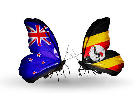 Two butterflies with flags on wings as symbol of relations New Zealand and Uganda photo