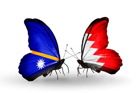 bahrain money: Two butterflies with flags on wings as symbol of relations Nauru and Bahrain Stock Photo
