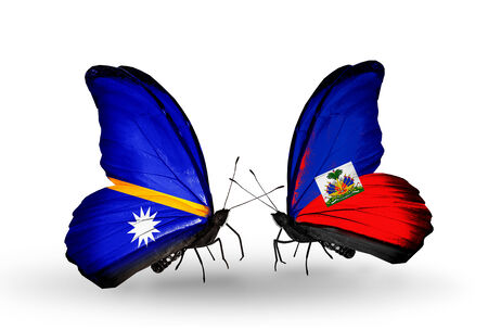 Two butterflies with flags on wings as symbol of relations Nauru and Haiti photo