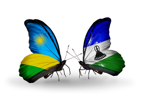 Two butterflies with flags on wings as symbol of relations Rwanda and Lesotho photo