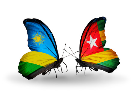 Two butterflies with flags on wings as symbol of relations Rwanda and Togo photo