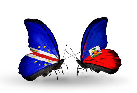 Two butterflies with flags on wings as symbol of relations Cape Verde and Haiti photo