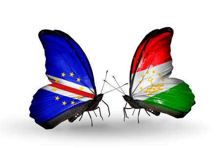 economy of tajikistan: Two butterflies with flags on wings as symbol of relations Cape Verde and Tajikistan Stock Photo