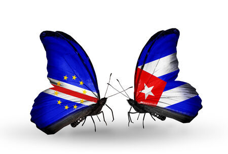 Two butterflies with flags on wings as symbol of relations Cape Verde and Cuba Stock Photo