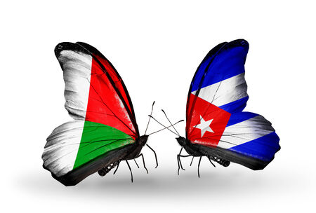 Two butterflies with flags on wings as symbol of relations Madagascar and  Cuba Stock Photo