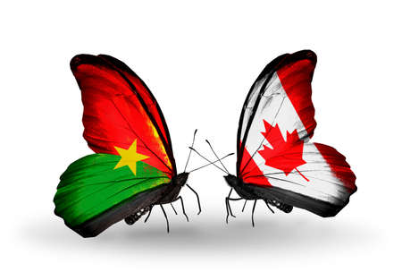 Two butterflies with flags on wings as symbol of relations Burkina Faso and Canada photo