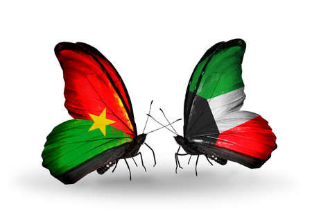 Two butterflies with flags on wings as symbol of relations Burkina Faso and Kuwait photo