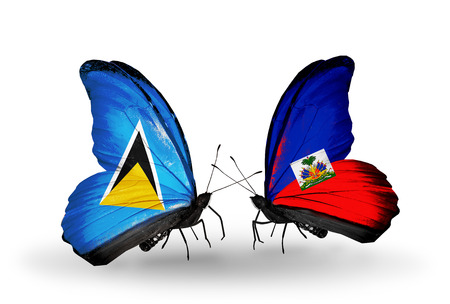 Two butterflies with flags on wings as symbol of relations Saint Lucia and Haiti photo