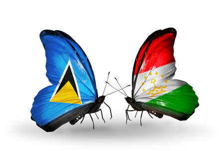 economy of tajikistan: Two butterflies with flags on wings as symbol of relations Saint Lucia and Tajikistan