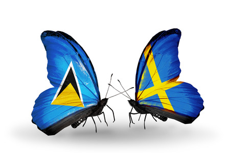 lucia: Two butterflies with flags on wings as symbol of relations Saint Lucia and Sweden