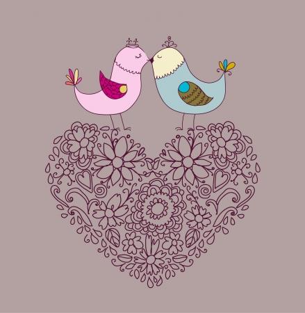 Flores en la forma de un corazón y aves