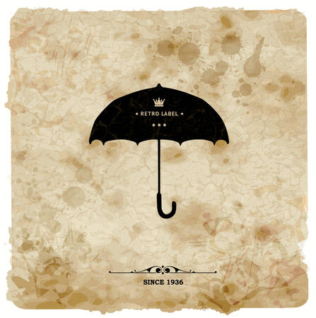 Vintage postcard. Retro umbrella on grunge background photo