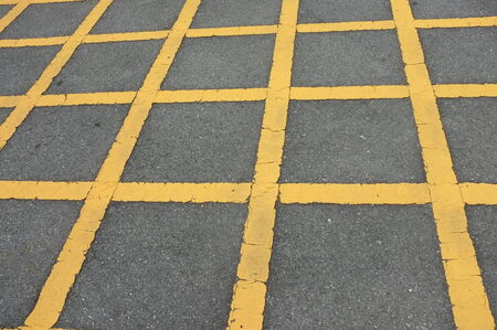 Road asphalt  texture with  lines yellow  pattern  No parking photo