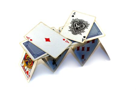 instability: House of cards on white background Editorial