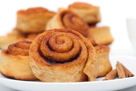 Cinnamon rolls group on the plate, white background