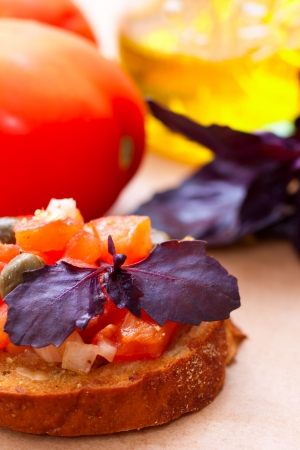 Italian bruscetta with tomatoes, olive oil and basil photo