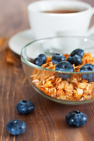 Granola with blueberry, cup of tea photo